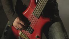 Rock musician is playing the red electric guitar smoke 4k Stock Footage