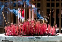 burning incense in a buddist temple - stock photo