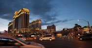 Stock Video Footage of 4K video of Caesars Palace Hotel and Casino at night in Las Vegas, Nevada