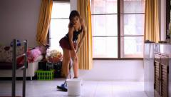 Beautiful young sexy maid cleans tiled floor, concept cleaning. Video Stock Footage