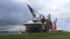 Thialf maintenance platform moored in Calandkanaal + pan Stock Footage