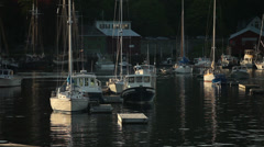 Boats bobbing in peaceful harbor, Camden, Maine - stock footage