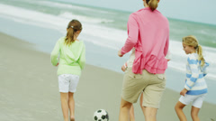 Caucasian Summer Family Warm Clothing Kicking Soccer Ball Beach Stock Footage