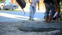 Pouring cement on the road and workers alignment it. Video Stock Footage