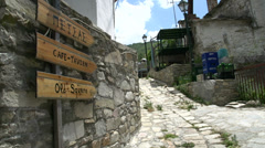 Pan from old square sign to a street in Maries, Thassos Greece Stock Footage