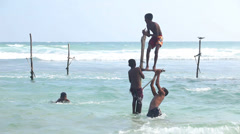 Young boys playing on a fishing pole in the ocean. Stock Footage