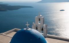 Blue domed church in santorini, greece Stock Photos