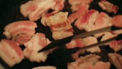 Raw bacon baking in pan Stock Footage