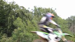 Motocross riders jumping Stock Footage