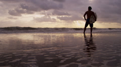 Solitary Male Surfer Sunset Beach Looking Ocean - stock footage