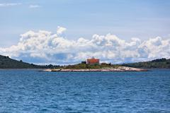 lighthouse on a small island in the adriatic sea - stock photo