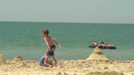 Stock Video Footage of Children playing in the sand on the Black Sea coast