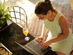 Businesswoman working on laptop by the table in kitchen NTSC Stock Footage