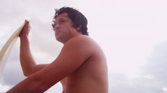 Close Up Young Hawaiian Male Holding Surfboard Beach - stock footage