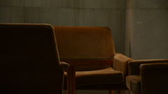 Chairs in empty old hall Stock Footage
