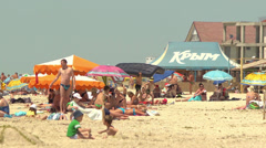 Black Sea beach holidaymakers - on an awning tent word  Crimea  in Russian Stock Footage