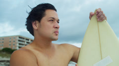 Portrait Rugged Young Hawaiian Male Holding Surfboard Beach - stock footage