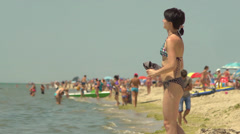 People relax on the shores of the Black Sea - stock footage