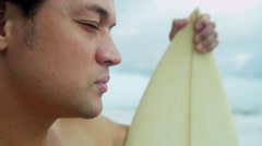 Close Up Solitary Male Ethnic Surfer Beach Looking Ocean - stock footage