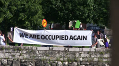 we are occupied again - demonstration - stock footage