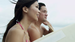Close Up Healthy Ethnic Surfing Couple Beach Looking Ocean Stock Footage