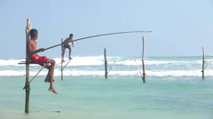 Young boy on a fishing pole in the ocean in Galle, Sri Lanka. Stock Footage