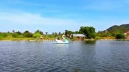 Stock Video Footage of catamaran at form of swan swimming with people in pond on background Of blue sky