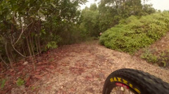 Mountain biking camera view near front tyre Stock Footage