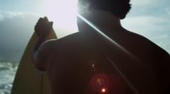 Rugged Young Hawaiian Male Holding Surfboard Beach - stock footage