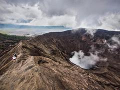 Hikers Walking Around the Rim of Gunung Bromo Volcano, East Java, Indonesia Stock Photos