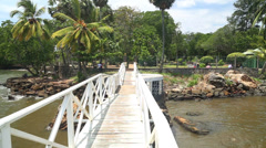 Tracking shot of bridge over river in Galle in Sri Lanka Stock Footage