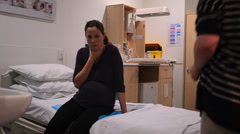 pregnant woman having contraction 02 - stock footage