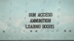 Gun ammunition door label stenciled on the side of a jet fighter Stock Footage