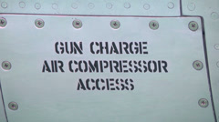 Gun door label stenciled on the side of a jet fighter Stock Footage