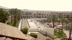 Beautiful green vegetation and palm trees on the hotel Stock Footage