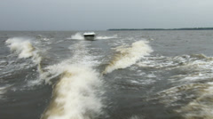 Boat navigating fast on a lake - stock footage