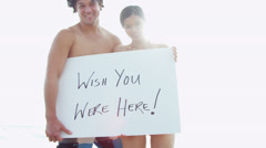Smiling Young Couple Close Up Holding White Message Board Stock Footage