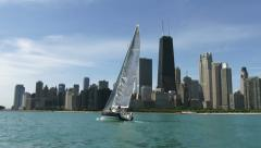 Sailing boat navigating in front of Chicago Stock Footage