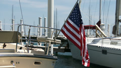 American flag waving on docked boat - stock footage