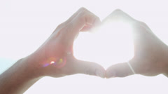 Close Up Ethnic Male Hands Only Heart Shaped Symbol - stock footage