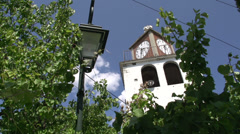 Tilt pan from church to street in Theologos, Thassos Greece Stock Footage