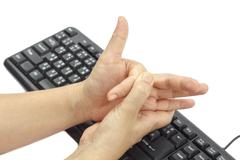 Painful finger due to prolonged use of keyboard and mouse. Stock Photos