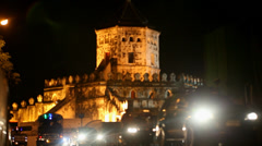 active traffic on the road at night in background of fortress Phra Sumen Fort. - stock footage