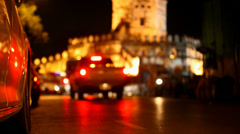 Active traffic on the road at night in background of fortress Phra Sumen Fort. Stock Footage