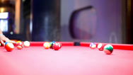 Stock Video Footage of Billiards pool game in the night bar. Beat cue balls. Video