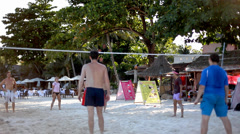KOH SAMUI, THAILAND, APRIL 26: guys playing beach volleyball on a tropical Stock Footage