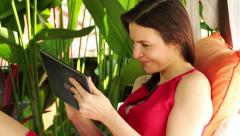 Pretty woman with tablet computer standing in the garden HD Stock Footage