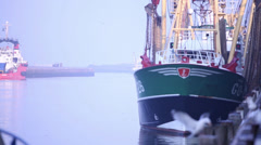 Fishing boat in harbor - stock footage