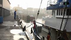 Fishingboat stops in harbor Stock Footage