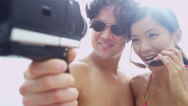 Close Up Asian Chinese Young Couple Smiling Filming Selfie Stock Footage